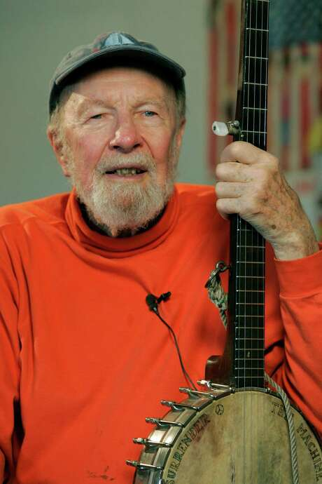 "Pete Seeger is photographed on May 5, 2006 in Beacon, N.Y. A book by Pete Seeger, ""The Deaf Musicians,"" about a young musician who loses his hearing was one of the winners of children's book prizes announced Monday, Jan. 22, 20067, by the American Library Association. Seeger and co-author Paul DuBois Jacobs received the Schneider Family Book Award for ""books that embody the artistic expression of the disability experience for child and adolescent audiences.""(AP Photo/Frank Franklin II) Photo: FRANK FRANKLIN II, STF / AP"