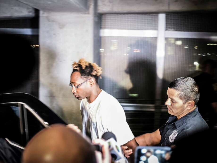 Otis Tyrone McKane, 31, a suspect in the shooting death of SAPD Det. Benjamin Marconi, is walked out of police headquarters downtown on Monday, November 21, 2016. Photo: Matthew Busch, For The San Antonio Express-News / © Matthew Busch