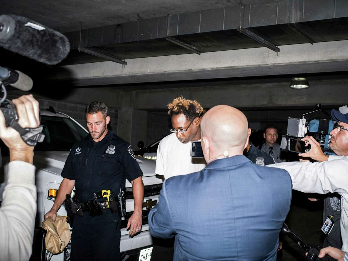 Otis Tyrone McKane, 31, a suspect in the shooting death of SAPD Det. Benjamin Marconi, is walked out of police headquarters downtown on Monday, November 21, 2016.