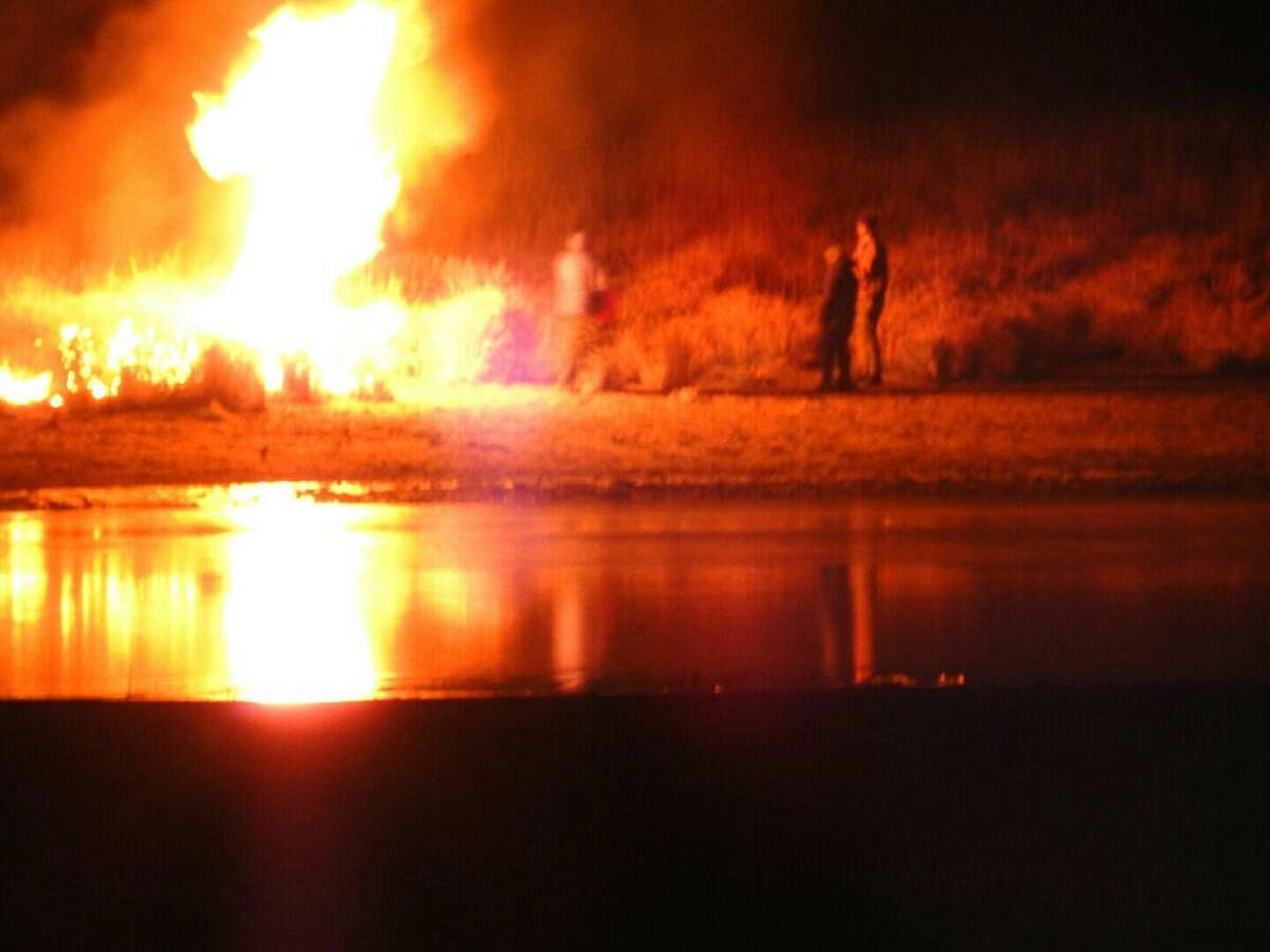 In this image provided by Morton County SheriffÂ?'s Department, law enforcement and protesters clash near the site of the Dakota Access pipeline on Sunday, Nov. 20, 2016, in Cannon Ball, N.D. The clash came as protesters sought to push past a bridge on a state highway that had been blockaded since late October, according to the Morton County Sheriff's Office. (Morton County SheriffÂ?'s Department via AP)