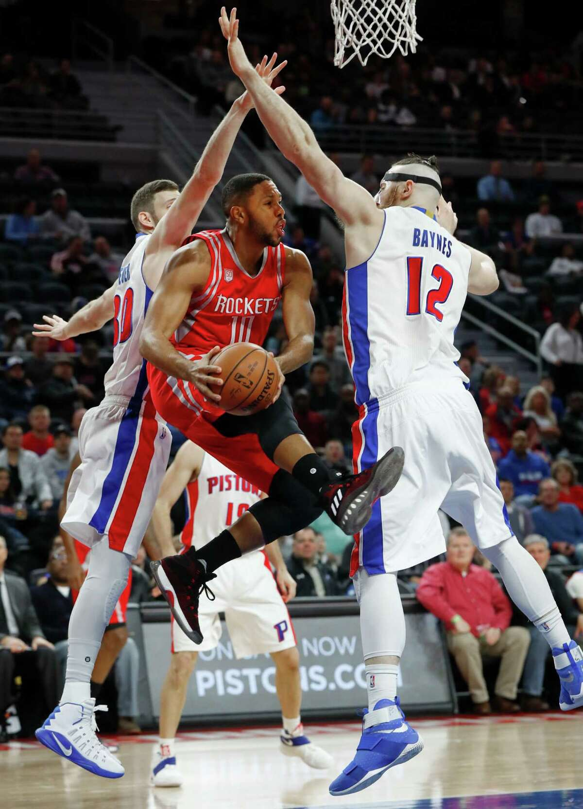 Eric Gordon, who was held scoreless on five field-goal attempts, tries to split a pair of Pistons.