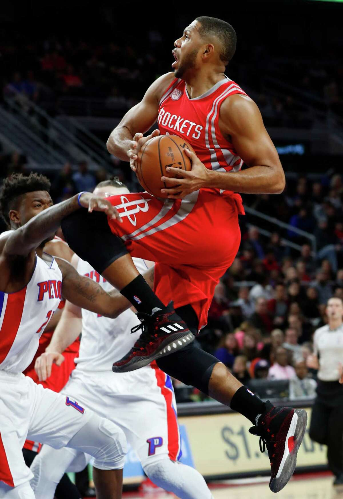 Houston Rockets guard Eric Gordon (10) drives against the Detroit Pistons in the first half of an NBA basketball game in Auburn Hills, Mich., Monday, Nov. 21, 2016. (AP Photo/Paul Sancya)