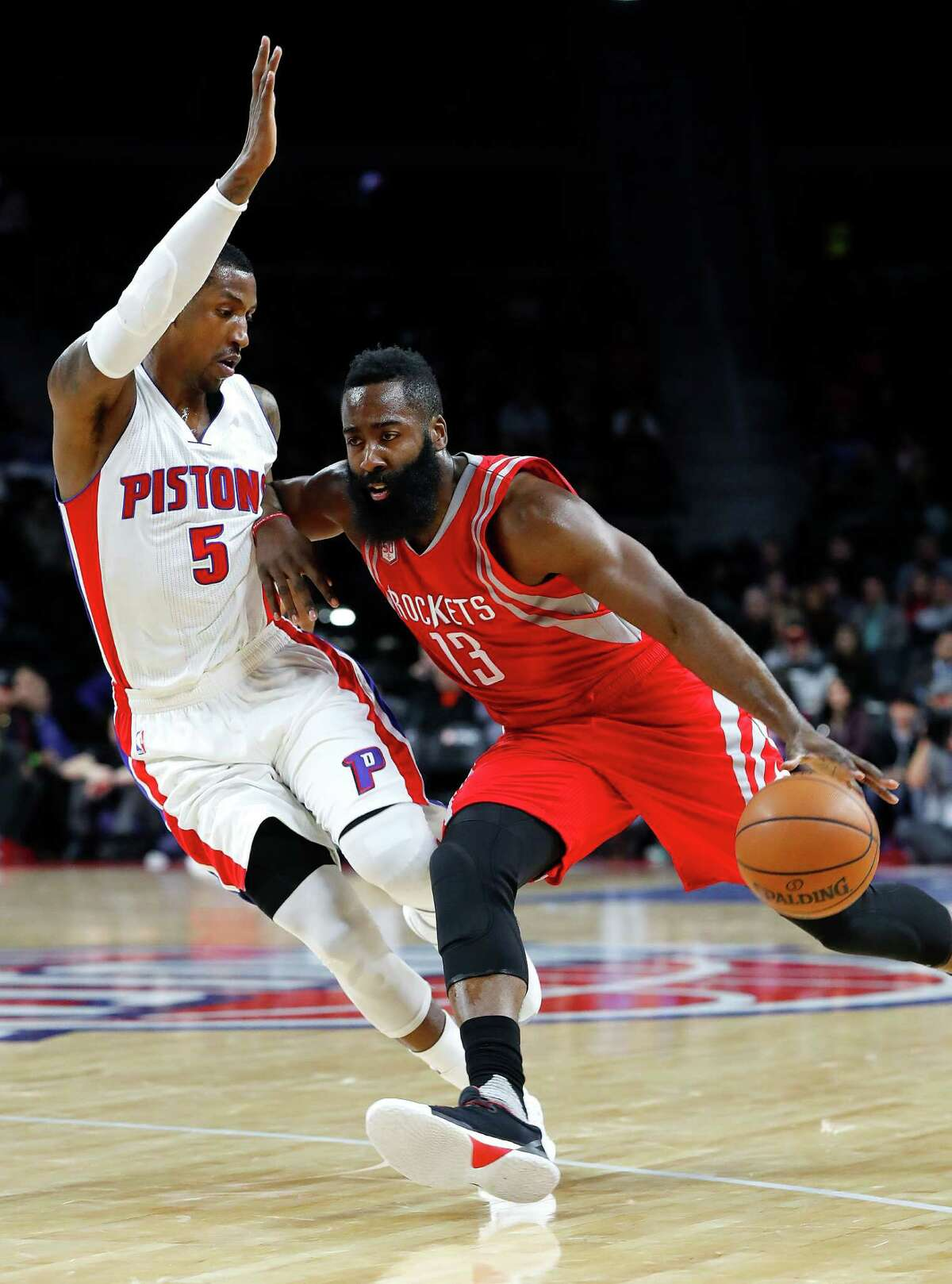 Houston Rockets guard James Harden (13) drives against Detroit Pistons guard Kentavious Caldwell-Pope (5) in the first half of an NBA basketball game in Auburn Hills, Mich., Monday, Nov. 21, 2016. (AP Photo/Paul Sancya)