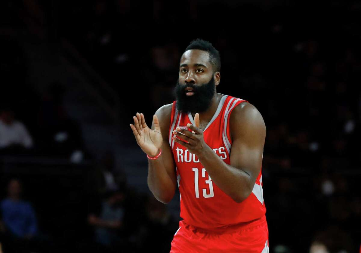 Houston Rockets guard James Harden (13) claps after a play against the Detroit Pistons in the first half of an NBA basketball game in Auburn Hills, Mich., Monday, Nov. 21, 2016. (AP Photo/Paul Sancya)