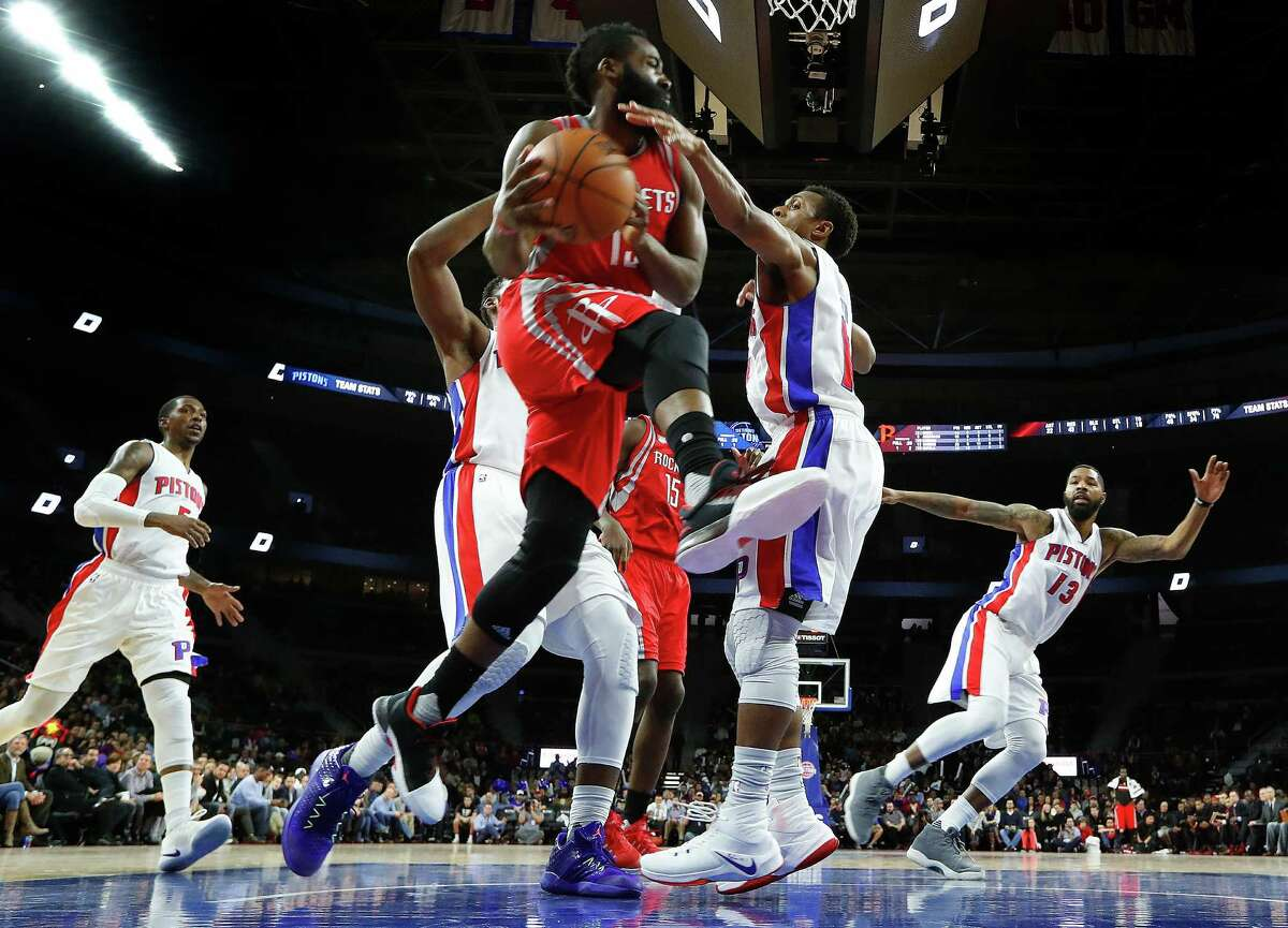 Houston Rockets guard James Harden (13) drives against Detroit Pistons guard Ish Smith (14) in the second half of an NBA basketball game in Auburn Hills, Mich., Monday, Nov. 21, 2016. (AP Photo/Paul Sancya)