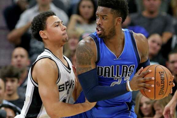 Spurs rookie Bryn Forbes defends the Mavericks' Wesley Matthews on Nov. 21.