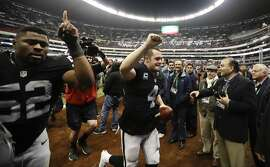 Oakland Raiders quarterback Derek Carr, center, reacts with teammate defensive end Khalil Mack (52) after an NFL football game against the Houston Texans Monday, Nov. 21, 2016, in Mexico City. The Raiders won, 27-20. (AP Photo/Eduardo Verdugo)