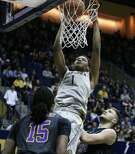 FILE - In this Nov. 20, 2015, file photo, California's Ivan Rabb scores against East Carolina in the second half of an NCAA college basketball game, in Berkeley, Calif. Rabb was selected to The Associated Press� preseason All-America college basketball team, Wednesday, Nov. 2, 2016. (AP Photo/Ben Margot, File)