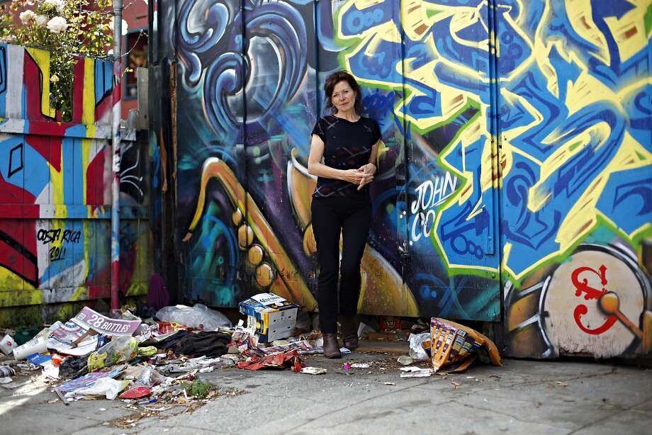 With a new biography on the songwriter Leonard Cohen, British music journalist Sylvie Simmons poses near her home on Thursday, August 30, 2012 in San Francisco, Calif. Photo: Beck Diefenbach, Special To The Chronicle