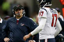 Houston Texans head coach Bill O'Brien stands by quarterback Brock Osweiler (17) as he walks to the sidelines during a time out during the fourth quarter against the Oakland Raiders of an NFL football game at Estadio Azteca on Monday, Nov. 21, 2016, in Mexico City.