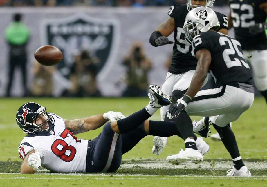 Houston Texans tight end C.J. Fiedorowicz (87) drops a pass after being tripped up by Oakland Raiders free safety Reggie Nelson, not pictured, during the second quarter of an NFL football game at Estadio Azteca on Monday, Nov. 21, 2016, in Mexico City. Fiedorowicz dropped the ball when he hit the ground for an incomplete pass. Photo: Brett Coomer, Houston Chronicle / © 2016 Houston Chronicle