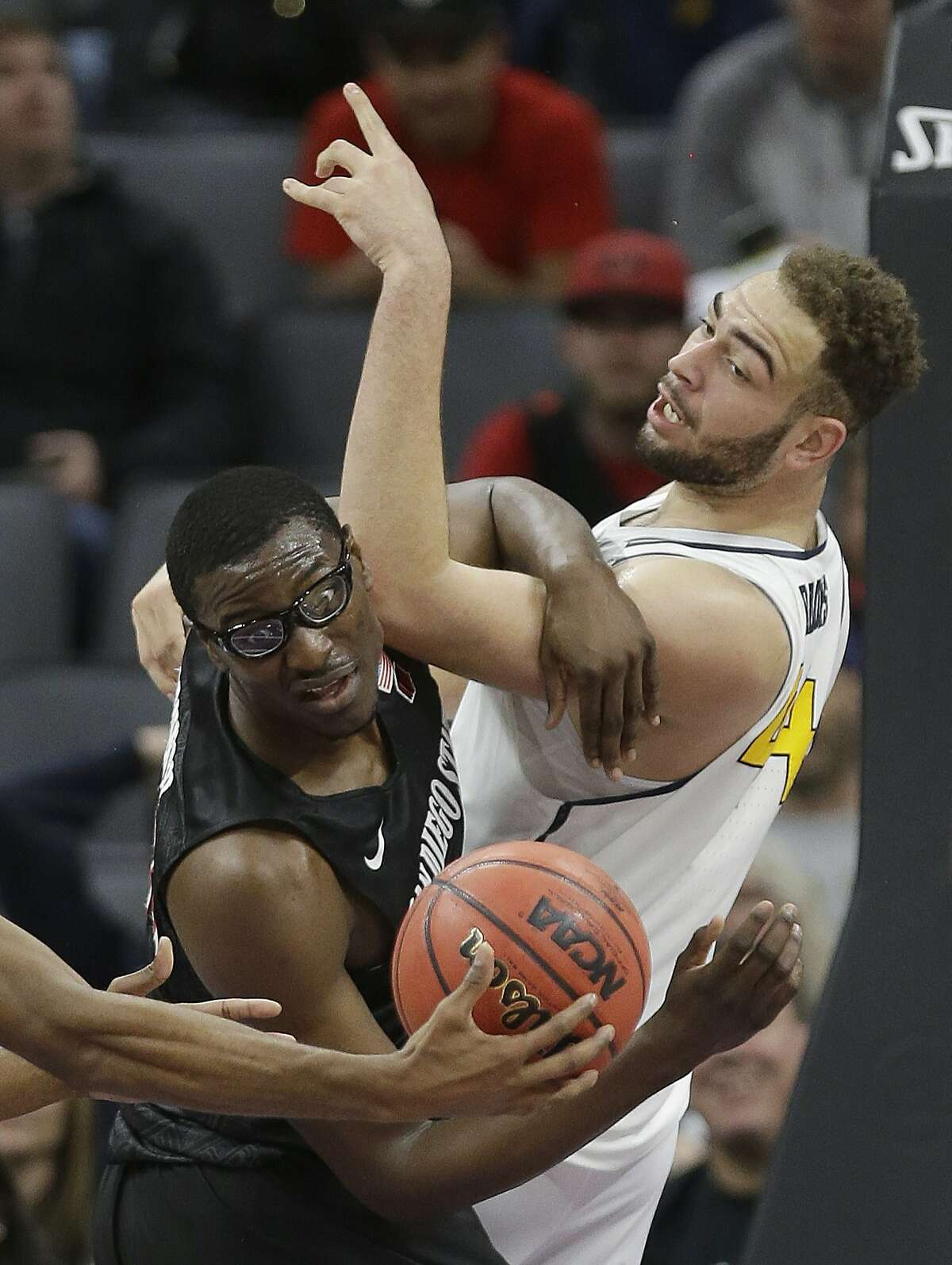 San Diego State Aztecs center Valentine Izundu, left, pulls a rebound away from California center Kameron Rooks during the first half of an NCAA college basketball game in Sacramento, Calif., Monday, Nov. 21, 2016. (AP Photo/Rich Pedroncelli)