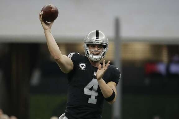 Oakland Raiders quarterback Derek Carr throws a pass during the first half of an NFL football game against the Houston Texans Monday, Nov. 21, 2016, in Mexico City. (AP Photo/Rebecca Blackwell)