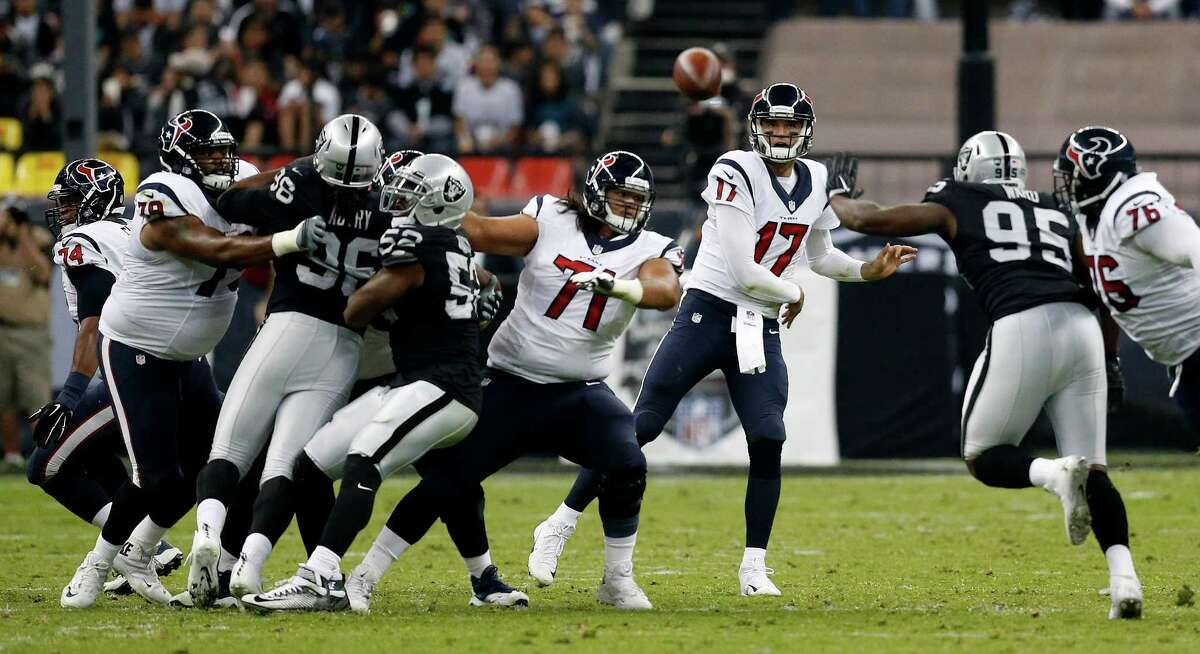 Texans quarterback Brock Osweiler delivers a pass during the second quarter of the loss to the Raiders. Osweiler was 26-for-39 passing for 243 yards and a touchdown with one interception.