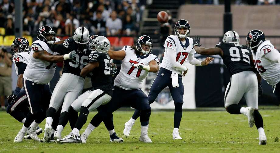 Texans quarterback Brock Osweiler delivers a pass during the second quarter of the loss to the Raiders. Osweiler was 26-for-39 passing for 243 yards and a touchdown with one interception. Photo: Brett Coomer, Staff / © 2016 Houston Chronicle