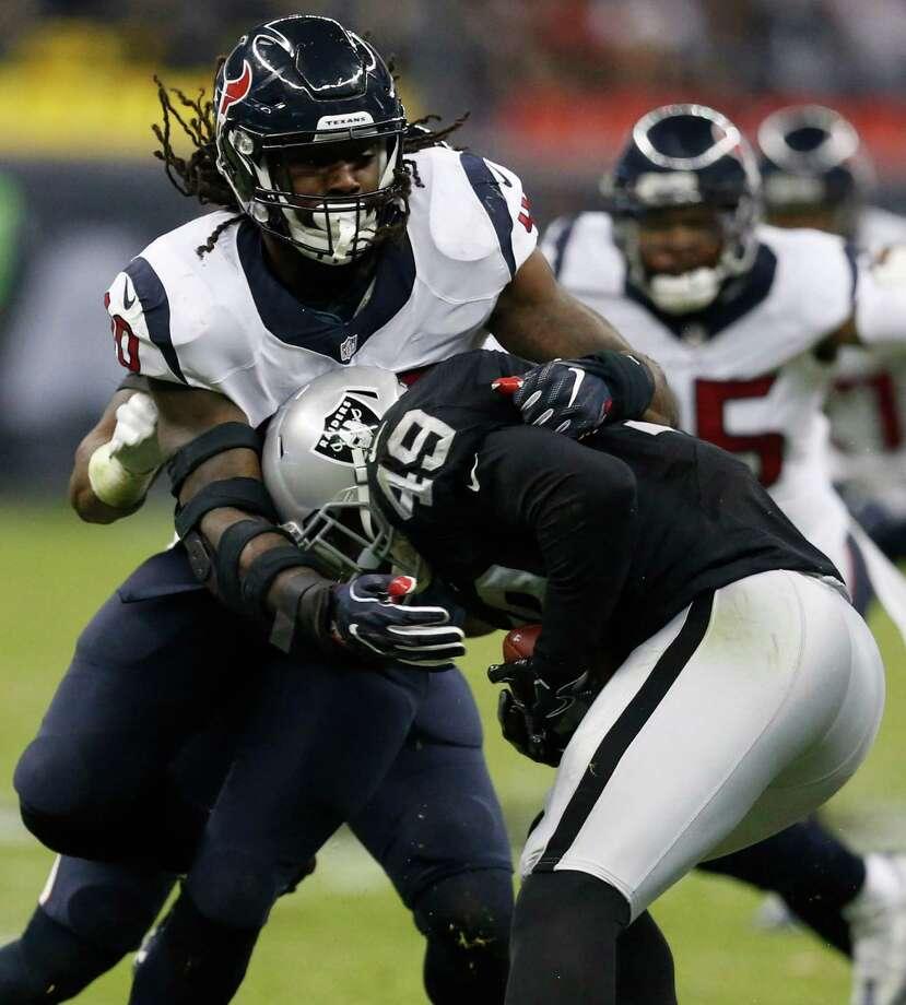 Houston Texans defensive end Jadeveon Clowney (90) stops Oakland Raiders fullback Jamize Olawale (49) during the second quarter of an NFL football game at Estadio Azteca on Monday, Nov. 21, 2016, in Mexico City. ( Brett Coomer / Houston Chronicle ) Photo: Brett Coomer, Staff / © 2016 Houston Chronicle