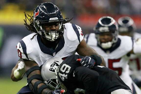 Houston Texans defensive end Jadeveon Clowney (90) stops Oakland Raiders fullback Jamize Olawale (49) during the second quarter of an NFL football game at Estadio Azteca on Monday, Nov. 21, 2016, in Mexico City. ( Brett Coomer / Houston Chronicle )