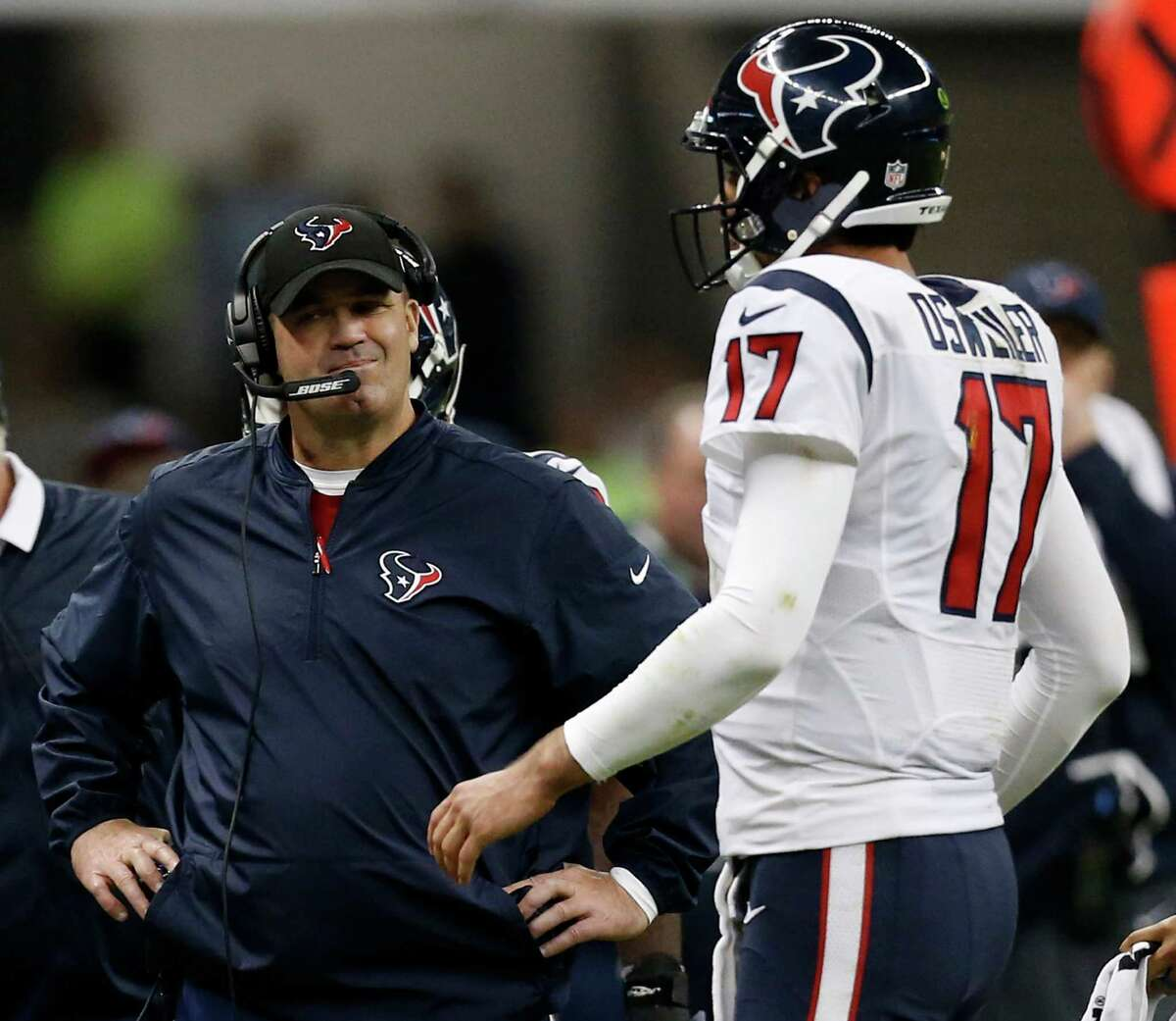 The threat of the Raiders' dynamic offense forced Texans coach Bill O'Brien, left, to be more aggressive with the Brock Osweiler-led offense in the fourth quarter.