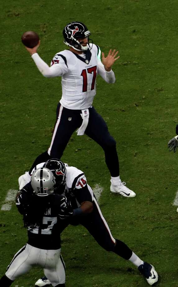 A green laser hits the jersey of Houston Texans quarterback Brock Osweiler as he looks to throw a pass during the second half of an NFL football game Monday, Nov. 21, 2016, in Mexico City. (AP Photo/Dario Lopez-Mills) Photo: Dario Lopez-Mills, Associated Press / AP