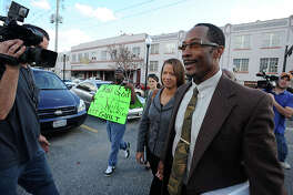 Followed by a throng of media, Calvin Walker exits the Federal Courthouse Thursday after the case against him was declared a mistrial.  Photo taken Thursday, December 16, 2011 Guiseppe Barranco/The Enterprise