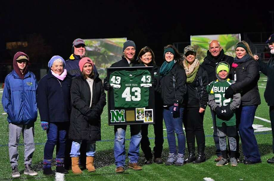 From left to right, celebrating Jack Lavalette's induction to the Gridiron Hall of Fame are sn Logan, wife Sarah, mother and father, Beth and Lenny, Jack Lavalette, Gridiron Club's Bev Ryan, Anne Flynn, Theresa D'Ambrosio, John Balzi, Trish Skelly and Jack Balzi. Photo: Contributed Photo