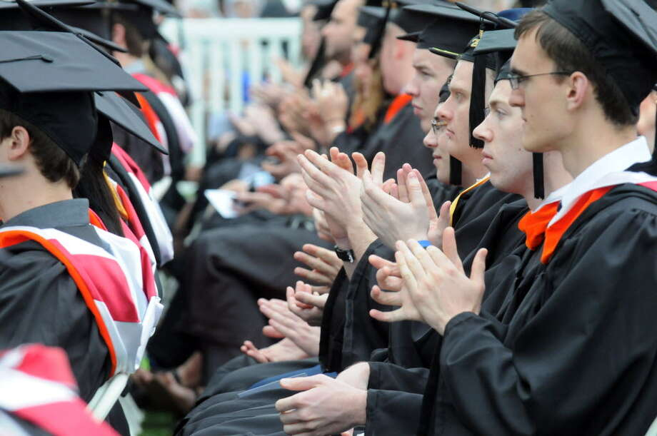 Graduates applaud as college president Shirley Ann Jackson gives greetings during the Rensselaer Polytechnic Institutes 208th commencement on Saturday May 24, 2014 in Troy, N.Y. (Michael P. Farrell/Times Union)