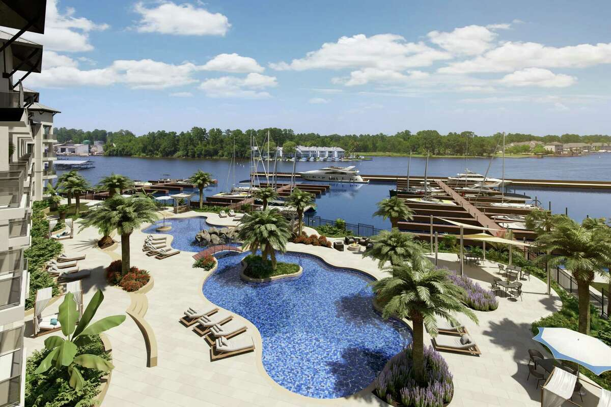 The Shoreline, a luxury condominium building, is being developed along Lake Conroe.