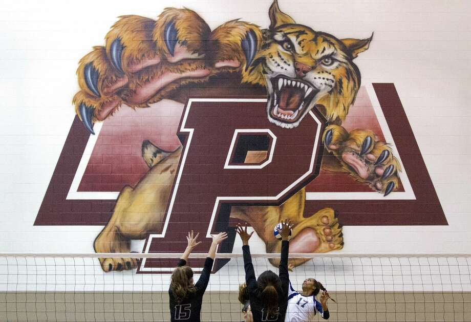 College Park outside hitter Angela Owusu (17) goes up against Rockwall outside hitter Avery McCrillis (15) and middle blocker Kim Iwunze (16) during the first set of a Region II-6A bi-district high school volleyball match at Palestine High School Tuesday, Nov. 1, 2016, in Palestine. Rockwall defeated College Park 3-1. Photo: Jason Fochtman/Houston Chronicle