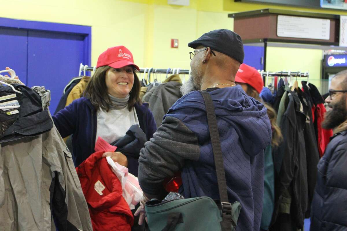 The Bridgeport Rescue Mission hosted their annual Great ThanksGiving Project at Bridgeport's Webster Bank Arena on Monday, Nov. 21, 2016, distributing turkeys, fixings, and warm clothing.