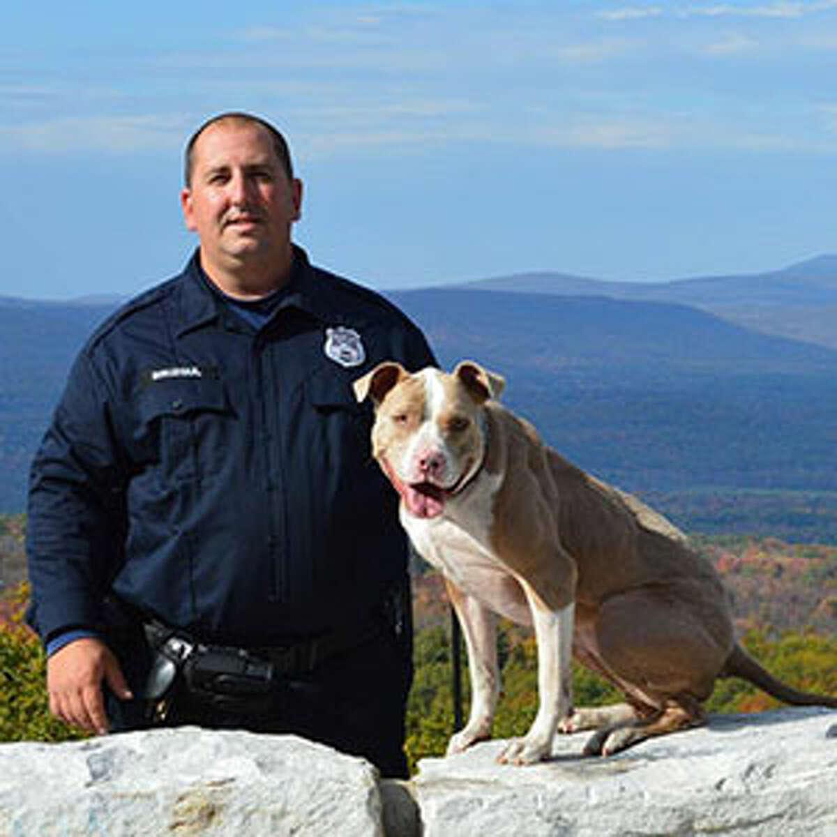 K9 Kiah poses with her handler, Poughkeepsie police Officer Justin Bruzgul. (Animal Farm Foundation)