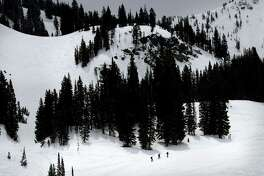 Skiers pay the price for late season turns at Alta, Utah, as they hike up the mountain. Utah resorts still want skiers and snowboarders to come enjoy their groomed slopes and high speed lifts this season, but they're also offering expanded options for people who want to get a taste of the backcountry without the risk of going alone.