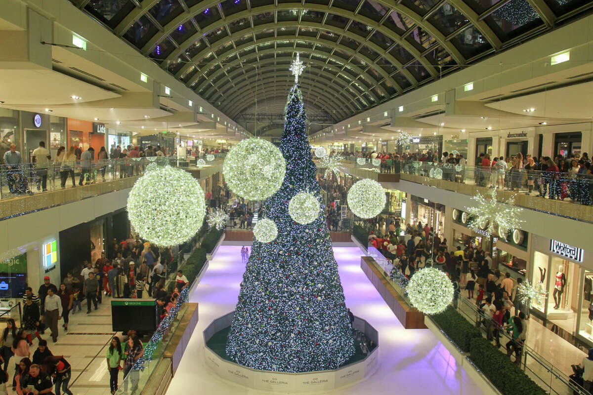 The Houston Galleria has new Christmas decor, with a family-size Santa throne, giant illuminated ornaments and twinkling trees throughout the mall.