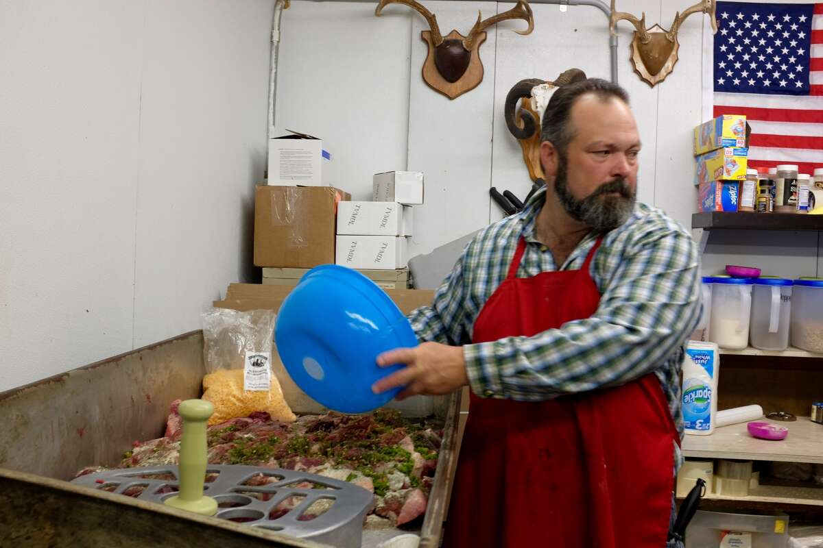 Shane Smith, whose family owns Freer Deer Camp in Freer, Texas, makes sausage. (Lydia DePillis/The Houston Chronicle)