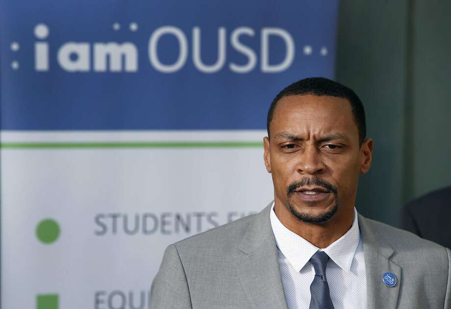 Oakland school board president James Harris announces that Superintendent Antwan Wilson is leaving the school district, at a news conference in Oakland, Calif. on Tuesday, Nov. 22, 2016. Wilson will step down from his position in February and will move to Washington, D.C. to become the Chancellor of District of Columbia Public Schools. Photo: Paul Chinn, The Chronicle