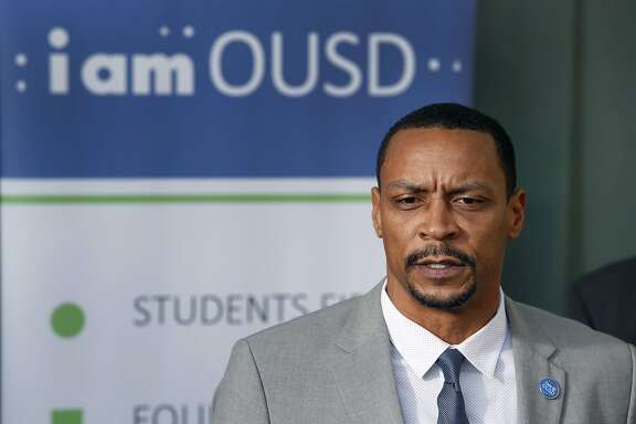 Oakland school board president James Harris announces that Superintendent Antwan Wilson is leaving the school district, at a news conference in Oakland, Calif. on Tuesday, Nov. 22, 2016. Wilson will step down from his position in February and will move to Washington, D.C. to become the Chancellor of District of Columbia Public Schools.