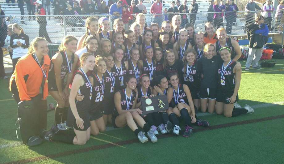 The New Canaan Rams field hockey team poses with its championship plaque after downing Guilford 3-1 in the Class M title game on Saturday at Wethersfield High School. The win was the second consecutive Class M title for the Rams. Photo: Anthony E. Parelli / Hearst Connecticut Media / New Canaan News