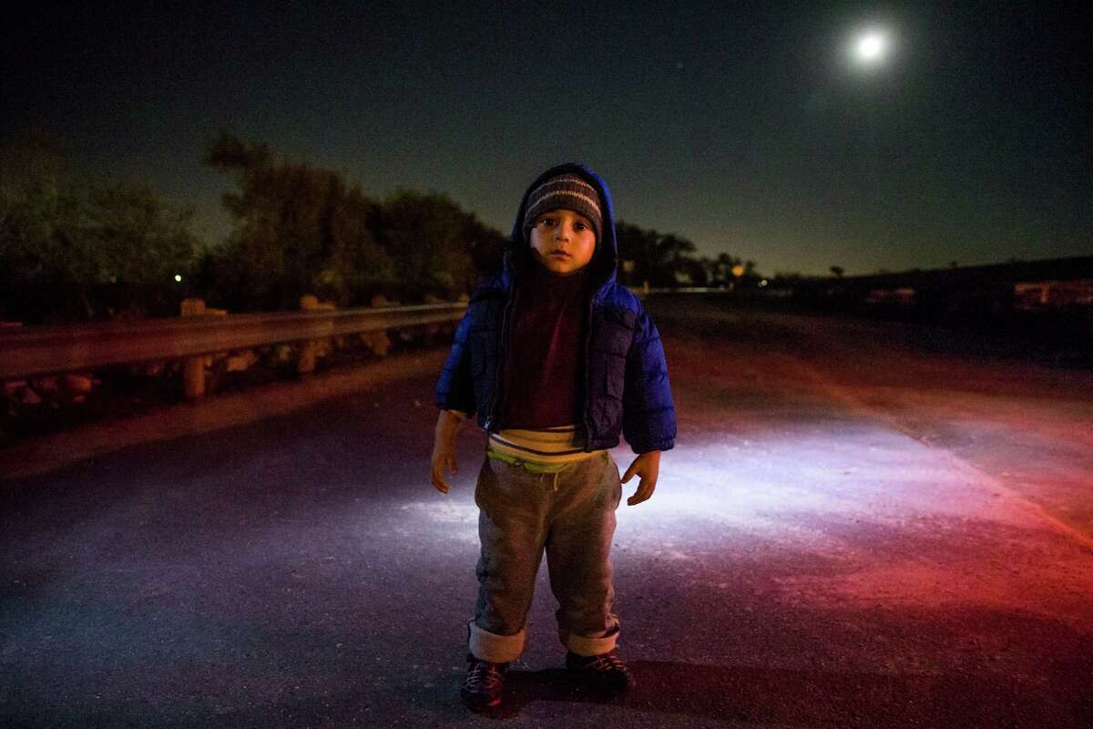 Luis Jafeth Duran, 3, stands under a full moon minutes after he and his mother, Jenny Marisa Rodriguez, surrendered themselves to Hidalgo County constables after crossing the border into the United States at Anzalduas Park Tuesday, Nov. 15, 2016 in Mission. Click here for more on this story