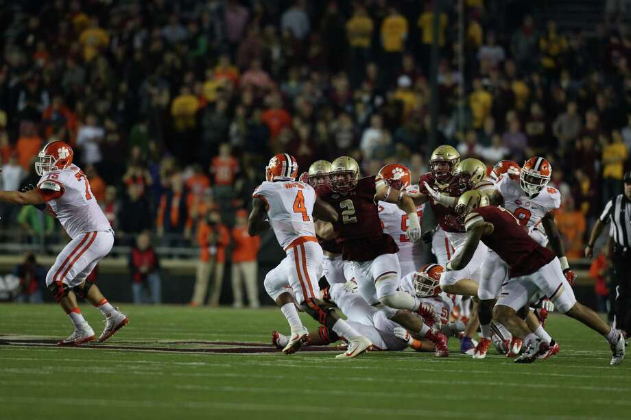 Boston College's Zach Allen (2) chases Clemson quarterback DeShaun Watson (4) on Oct. 7 in Chestnut Hill, Mass. Photo: Boston College Athletics / Contributed Photo / Stamford Advocate Contributed