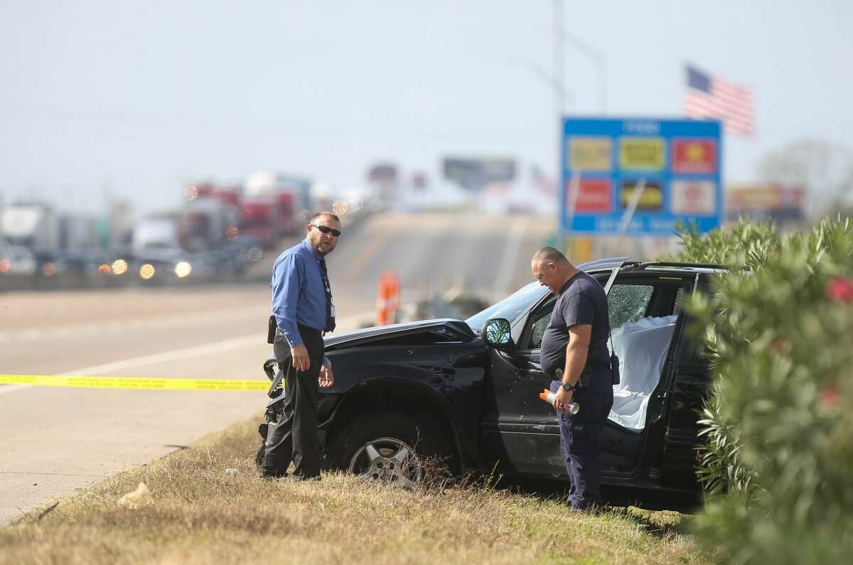 Authorities investigate the scene where a police chase ended in a crash and an officer-involved shooting on I-10 near Sjolander Road in Baytown, Tuesday, Nov. 22, 2016.