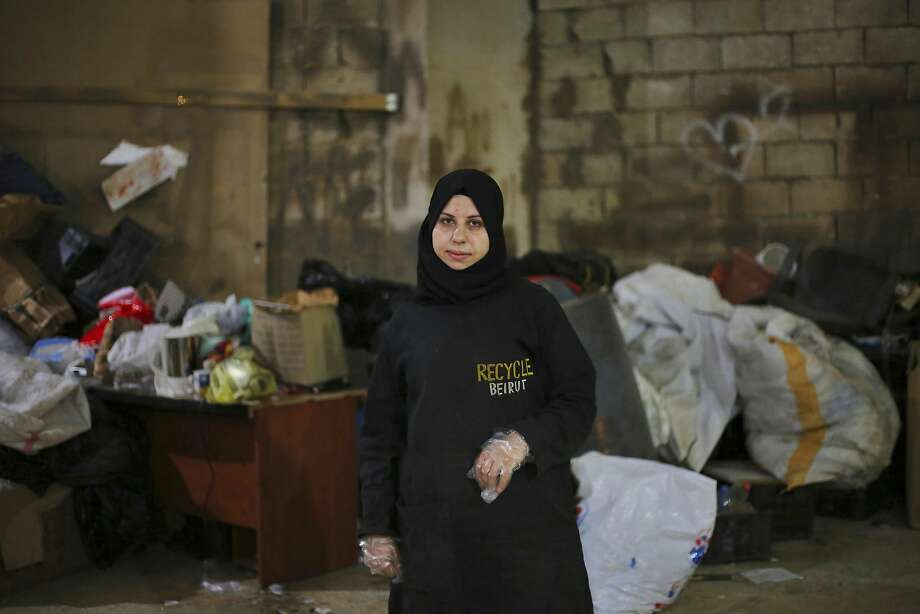 Syrian refugee Haela Kalawi, 31, works at Recycle Beirut in a poor community of Lebanon's capital. Photo: Bilal Hussein, Associated Press