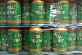 """Bakfish Brewing Co. in Pearland is getting ready to sell cans of its wit beer """"I Tell You Wit"""" in Pearland stores. For now, beer lovers can pick up a six-pack for $8.50 at the brewery to take home."""