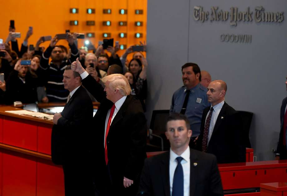 """US President-elect  Donald Trump  waves to the crowd after leaving a meeting at the New York Times on November 22, 2016 in New York. US President-elect Trump said Tuesday he has an open-mind about pulling out of world climate accords and admitted global warming may be in some way linked to human activity.""""I think there is some connectivity. Some, something. It depends on how much,"""" he told a panel of New York Times journalists.   / AFP PHOTO / TIMOTHY A. CLARYTIMOTHY A. CLARY/AFP/Getty Images Photo: TIMOTHY A. CLARY, AFP/Getty Images"""