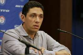 Texas Rangers general manager Jon Daniels speaks to reporters at the baseball park in Arlington, Texas, Tuesday, Oct. 11, 2016. What's next for general manager Jon Daniels and the Texas Rangers? Instead of a long postseason run led by their aces, Texas was swept out of the ALDS. Suddenly there are questions after winning an AL-high 95 games. (AP Photo/LM Otero)