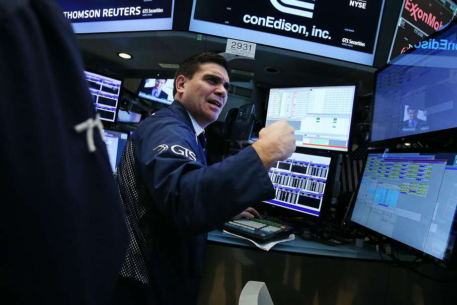 Traders work at the New York Stock Exchange in November. The president- elect's blistering critiques of firms on Twitter has at times hurt stock prices. Photo: Spencer Platt, Getty Images