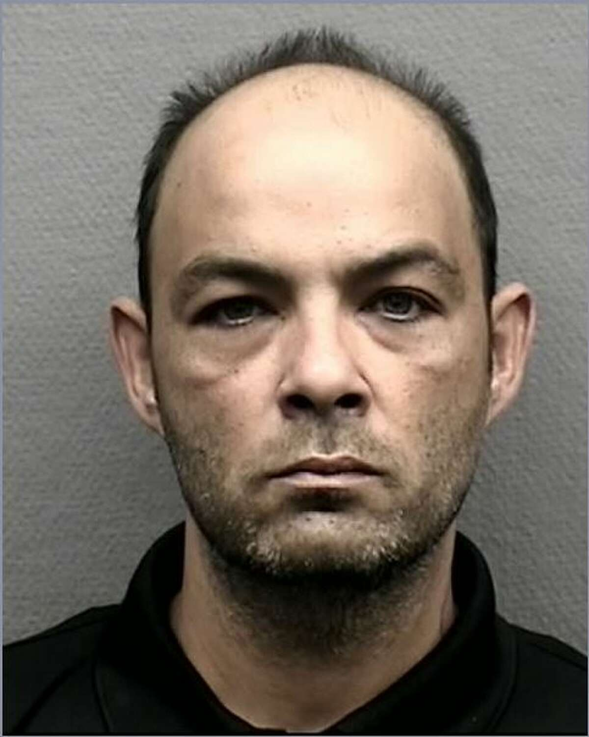 John Thompson, 40, is charged with burglary. According to the Harris County Precinct 1 Constable's Office, Thompson was part of a scam where he posed as a tree trimmer and then robbed homes.