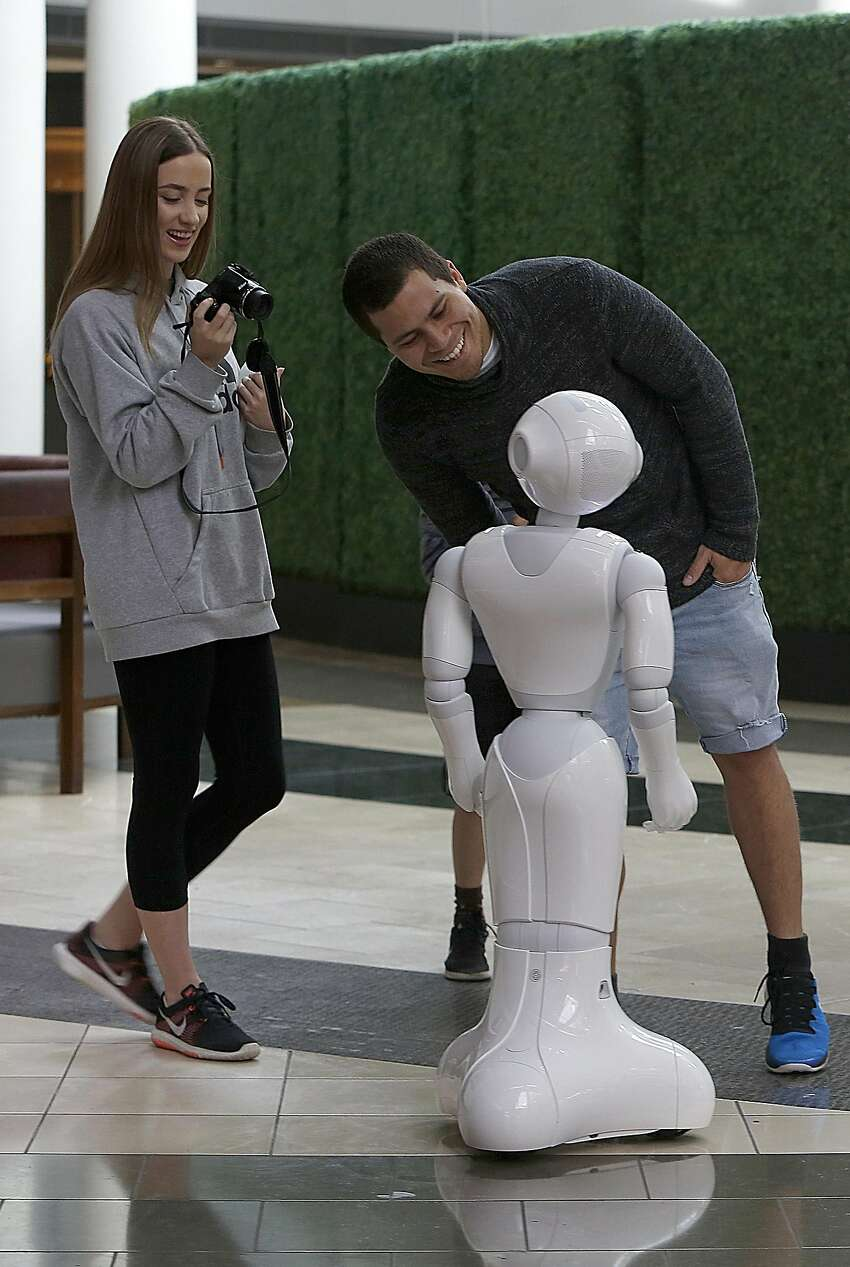 Meagan Bebendorf and Alex McArthur from Australia meet Pepper.