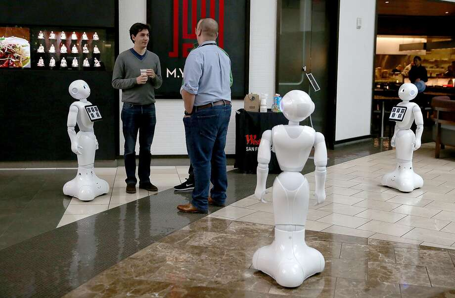 Three Peppers, robots by SoftBank Robotics, at Westfield SF Centre. Photo: Liz Hafalia, The Chronicle