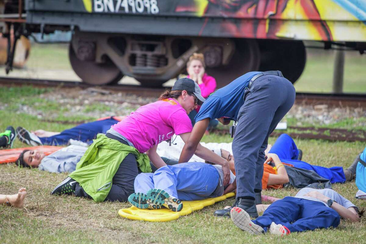 Students gain some experience during a mass casualty exercise presented by the UT Health system on Friday, Nov. 18, in the Houston Medical Center area.