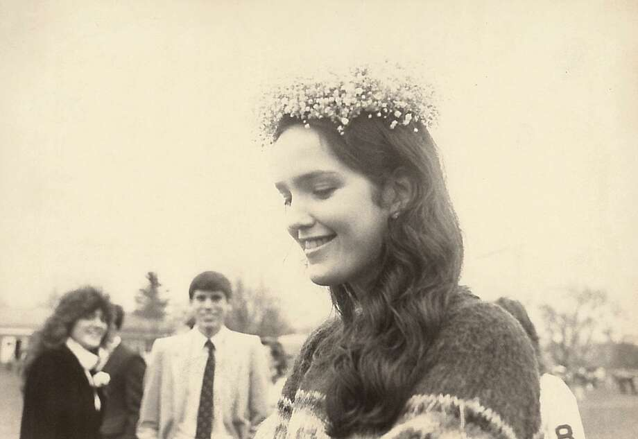 St. Mary's Homecoming Queen Nancy McKay is photographed on Nov. 25, 1983, after her crowning at a football game at the North Street school. In the background are schoolmates Beatrice Neri, left, and Bill Mottolese, right. Photo: Mel Greer /