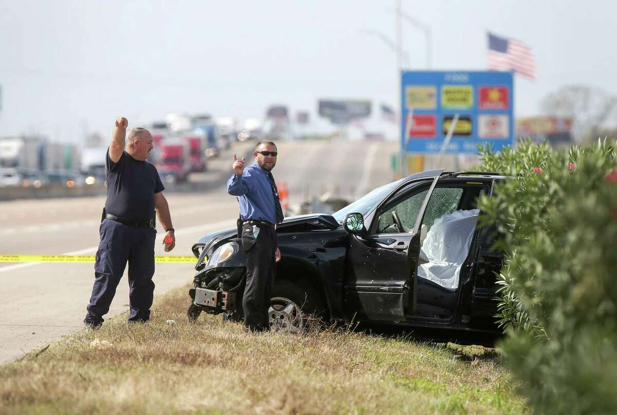 Authorities investigate after a police chase ended in a fatal shooting on I-10 near Sjolander Road in Baytown on Tuesday.
